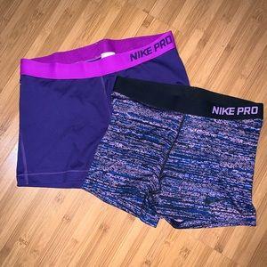 2 Purple Nike Pros